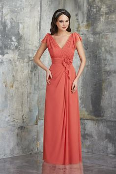 The color pictured in the sample is Coral V-neck with shirred bust and shoulders, flowers at waist and soft draped skirt.