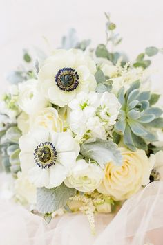 White anemone, sweet pea, ranunculus, rose, and succulent bouquet by The Flower Mill | Photo by Christy Nicole Photography | Rustic Inn New Jersey Wedding on heartlovealways.com