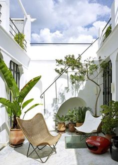 a white cool outdoor patio without a lot of plants! Great garden for black thumbs.