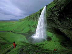 Seljalandsfoss Falls in Iceland. This waterfall of the river Seljalandsá drops 60 metres (200 ft) over the cliffs of the former coastline.