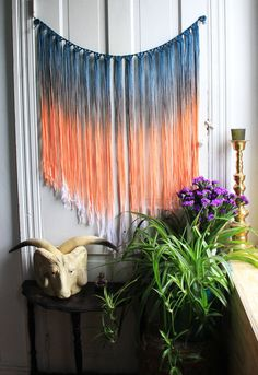 Handmade and dyed macrame wall, window, doorway, or anywhere hanging...25'' wide and 24''at it's longest point This wall hanging is dyed two colors: denim blue