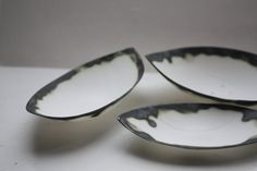 Stoneware fine bone china bowl with black rims resembles a small boat.   by madebymanos