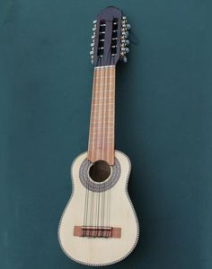 "Original and beautiful, the ""charango"" is an Andean folk instrument which evolved from the 16th/17th century Spanish vihuela de mano. It looks like a small guitar but has 10 strings separated into 5 courses.It features a body carved out of a solid block of wood and has a round back. http://www.thelatinstore.com.au"