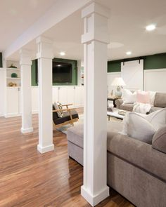 basement flooring How to turn support poles into columns - easy to tutorial showing how to cover basement poles with simple building materials so they become columns. Basement Bedrooms, Basement Walls, Basement Flooring, Basement Bathroom, Flooring Ideas, Basement Pole Ideas, Basement Pole Covers, Basement Family Rooms, Basement Layout