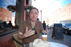 One of our funniest and most-talented entertainers, Mark Critch, enjoys a coffee on Water Street. This guy has the quickest mind of anyone I've ever met - he comes up with new material constantly and continuously. To read my profile of Mark, please visit: http://www.thetelegram.com/Blog-Article/b/11419/A-Fathers-Influence    Please forgive the lack of quotation marks in the article. Somehow, they got stripped out when the paper changed its site architecture. (Geoff Meeker photo)