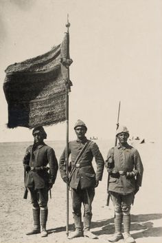 Ottoman soldiers with a regimental standard awarded for their service in the First Battle of Gaza where they defeated the British, 1917.