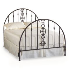 "GRAFTON GATE BED -- From our very first catalog and just as covetable 25 years later, this handsome, handcrafted iron bed was originally designed from a photo of a gate Robert Redford took while vacationing in France. Handmade in a 100-year-old American foundry, in iron with a multi-step hand-rusted finish. Bed rails are made from recycled railroad rails, decorative castings are recycled aluminum. USA. Exclusive. Queen, 61""W x 84-1/2""L x 57""H; King 78""W x 84-1/2""L x 57""H."