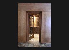 cellar door with wrought ironwork and Maple hardwood paneled walls