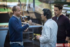 Director Joss Whedon on set with Robert Downey Jr. and Mark Ruffalo while filming Marvel's 'Avengers: Age of Ultron'