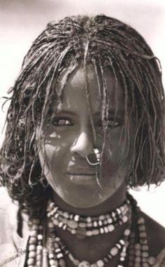 Attractive Beja girl showing distinctive hairsytle (teffa).
