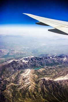 39,000ft above Iran. - Got a lucky shot of these beautiful snow capped mountains just an hour from landing in Dubai from Orlando over West Iran.