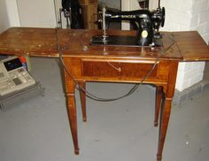 A 1935 Electric Singer Sewing Machine Identical To This One Sits At The Top  Of The Stairs.