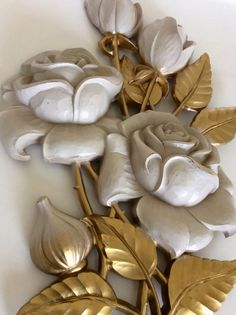 This is a beautiful large Syroco wall plaque made of a sturdy plastic composite material. Statement wall decor, large aged white roses & gold leaves create a beautiful statement for any room! In excellent vintage condition with hook on back for hanging. Stamped Syroco on back. Great for shabby chic decor, french country decor, baby nursery, cottage decor, or bathroom decor! Matching Syroco clock sold separately in shop!  Measures a little over 18 height x 11.75 wide x 1.5 depth  Thanks for…