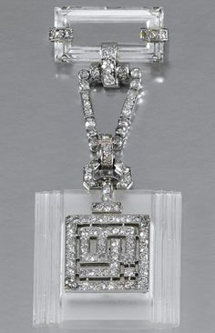 A LADY'S ROCK CRYSTAL AND DIAMOND FOB WATCH, 1930s. The square shaped plaque of carved rock crystal, decorated to the front with diamond set, interlocking initials depicting the letters 'LB', the reverse with square dial applied with Roman numerals and blued steel hands, suspended from a rock crystal and diamond surmount, set with baguette, circular- and single-cut stones, French assay marks.