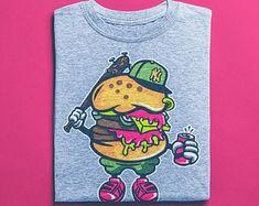 View Surf Shirts by BuyVintageShirts on Etsy Skater Shirts, Good Birthday Presents, Surf Shirt, African Safari, Vintage Shirts, Tshirts Online, Vintage Designs, Comic Art, Skateboard