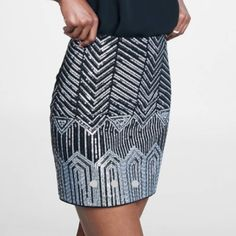NWT Art Deco Sequin Mini Skirt PRICE FIRM UNLESS BUNDLEDThis lavishly shimmering mini is a study of symmetry and sparkle with all-over embellishment that gives its classic inspiration a cutting edge. Express Skirts Mini