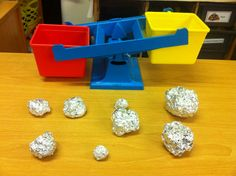 "Moon Rocks. Different items wrapped in tin foil to become ""Moon Rocks"" the idea was for the children to understand the biggest item isn't always the heaviest, and the smallest isn't always the lightest. My class were inspired and have been bringing in their own ""Moon Rocks"" from home and a lot of children are choosing to weigh using fantastic language."