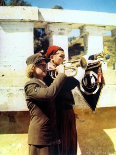An American WAC and the bugler of the famous First Zouave Regiment of North Africa combine under Mediterranean skies to sound an Army call. Women's Army Corps, Ww2 Pictures, Royalty Free Pictures, German Army, Female Photographers, Military History, Us Army, Colorful Pictures, World War Two