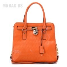 MICHAEL Michael Kors Hamilton Large Woven Tote Persimmon  Items Description * Persimmon woven soft leather with smooth tonal trim. * Golden hardware. * Top handles; 4 3/4cm drop. * Frame top with MK logo-engraved lock detail. * Hanging luggage tag. * Inside, one zip pocket, three open pockets, and one cell pocket. * Protective feet on bottom. * 13cm H x 14cm W x 6 1/4cm D. * Imported.