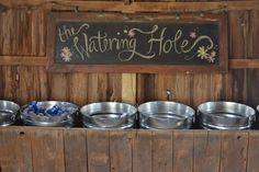 Using an old horse trough for a drink station for barn wedding decor.  MargotMadison