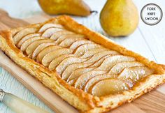 Ginger Pear Puff-Pastry Tart |1 sheet of frozen puff pastry, defrosted 2 pears, thinly sliced 2 tbsp unsalted butter, melted 1 tbsp brown sugar 1 tsp fresh ginger, finely minced 1 tsp pure vanilla extract 1/2 tsp ground cinnamon 1 tbsp demerara sugar (or sanding sugar)