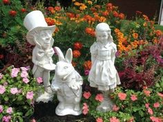 Alice in Wonderland garden ornaments. Victorian Trading Co. I want the White Rabbit. :)