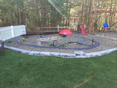 My husband created the ultimate play area for our kids: outside race track, monster truck pit , airport & pond.
