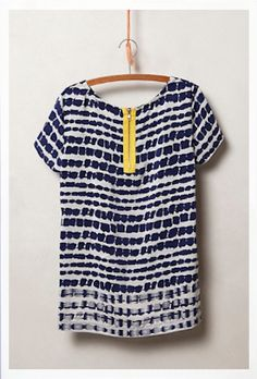 pretty navy shirt with a hint of color http://rstyle.me/n/mc5mrr9te