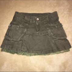 """Olive denim mini skirt with lace underlay Olive denim mini skirt with an attached lace-trimmed slip that peeks out the bottom. So cute! Length is 12"""", waist is 30"""". The only tag is a tiny one inside that says """"M"""". If anyone can tell by the buttons, let me know! GUC.  I'm open to offers and bundle discounts!! ☮❤️✌️ Skirts Mini"""