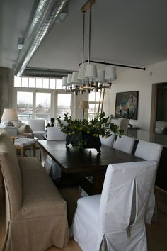 Loft dining room. Featuring our Dublin dining table with slipcovered Parsons chairs and Parsons dining bench