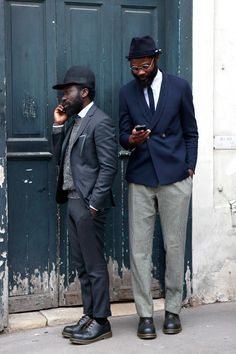 These guys just know how to kill it. / Lethal tailoring on the grey suit. To finish it off he's donned a deliciously textured sweater and a funky jockey-ish cap.