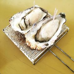 Eating some grilled oysters in Hiroshima.