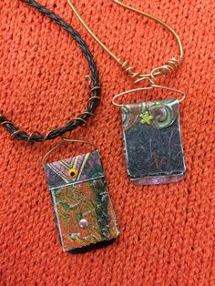 Artist Jean Angle designed these mixed media necklaces.....these make a special gift for someone special!!!