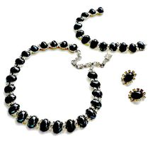 Vintage Bogoff Black Hematite Set Mint in Box This is a rare signed Bogoff set that includes a necklace, a bracelet and clip back earrings.