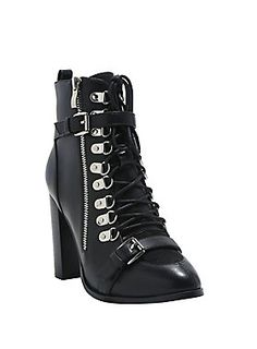 """<div>These boots were made for walking and kicking ass, and that's just what they'll do. The black faux leather lace-up booties have 9 rows of silver tone D-rings, a solid 4"""" heel, a suede toe box and a thin buckle over the toe and ankle. Side zipper closure.</div><div><ul><li style=""""list-style-position: inside !important; list-style-type: disc !important"""">Man-made upper</li><li style=""""list-style-position: inside !important; list-style-type: disc !important"""">4"""" heel</li><li style=""""list..."""