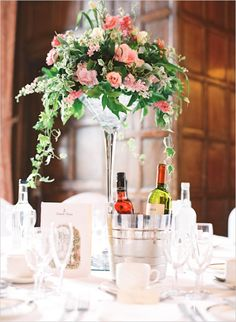 tall cascading floral centerpiece #weddingreception #centerpiece #weddingchicks http://www.weddingchicks.com/2014/02/07/british-beauty-wedding/