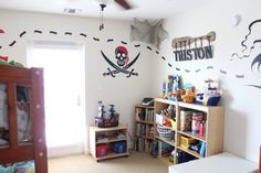 Pirate Bedroom, Pirate themed bedroom with pirate ship decal, skull decal, hanging name on boat paddle, and Lego Pirates bedding., Boys Rooms Design