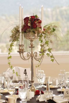 Paula's candleholder with Christmas greenery and red or white roses? Floral Design of Europe