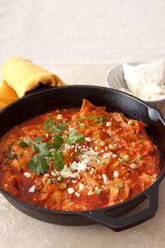Chicken Chilaquiles ~ instead of the red chile I dumped a 28oz can of macayos green chile enchilada sauce in :)