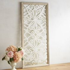 Our handcrafted wall panel is part mirror, mostly mosaic and totally stunning. Glass mirror mosaic in a beautiful swirling pattern is framed in finely finished mango wood. A sophisticated addition to any room, it will enhance your already dazzling decor.