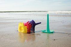 Triplet. Quut (cute) beach toy! 4-in-1 tool: shovel, sieve, rake and water funnel.  Durable versatility for endless fun. www.quutbeachtoys.com