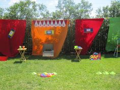 For my daughter's 8th carnival birthday party, we strung a rope across the backyard and set up 10 carnival game stations.  Each kid was given 20 tickets so they could play a few games.  Neighborhood teens ran the stations and handed out prizes from Oriental Trading Company.  See other pins for the 3 food tables.