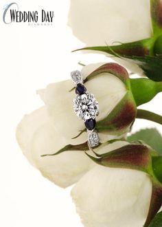 One of our favorite three stone styles - the pear shaped sapphire side stones and the antique inspired details are truly stunning. So unique and beautiful.