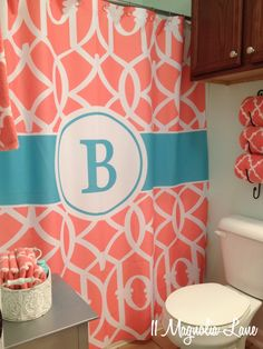 I love the color combo and also the rack over the toilet for the towels