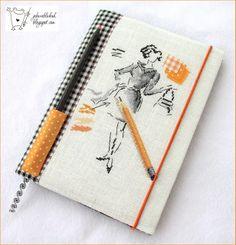 Hand made notebook, cross stitching on inen