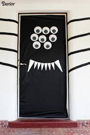 pin for later 7 halloween front door diys that are sure to get noticed by trick or treaters spooky spider get your craft on with this spooky spider door - Halloween Front Doors