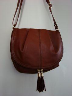 H & M, brown tassel crossbody bag, $17.99.