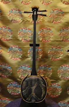 Sanshin / 三線 is an Okinawan musical instrument and precursor of the Japanese shamisen. Traditionally, it was covered with the skin of the Burmese python, but today, due to CITES regulations, the skin of the python reticulatus is also used.
