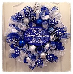 Wow, this beautiful Blue Merry Christmas Wreath will brighten your home this Holiday Season!! It is made with blue, silver and white deco