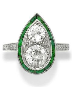 An Art Deco diamond, green stone and platinum ring. #ArtDeco #ring